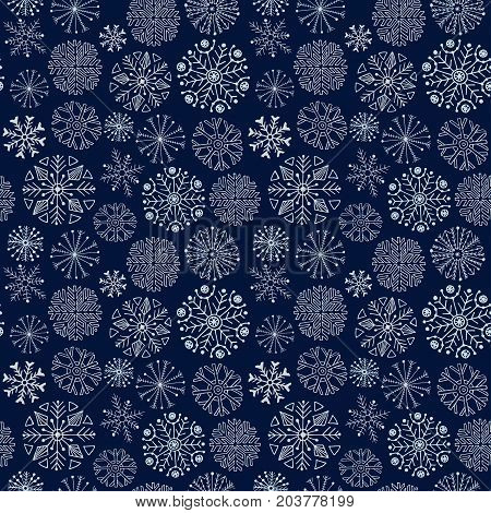 Snowflakes seamless pattern. Dark winter background. Christmas and New Year design wrapping paper design
