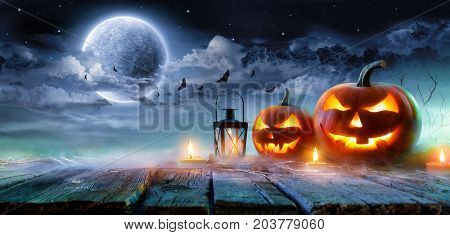 Jack O' Lanterns Glowing At Moonlight In The Spooky Night - Halloween Scene