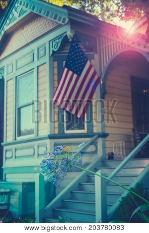 Retro Style Quintessential American Home Proudly Flying The USA Flag