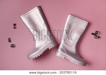 Rain Boots And Glass Balls On Pink