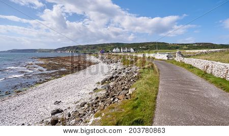 Road and a white wall on Rathlin Island, Antrim, Northern Ireland