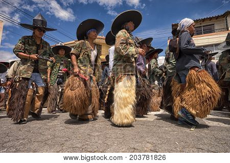 June 25 2017 Cotacachi Ecuador: low angle view of quechua indigenous men wearing chaps at Inti Raymi celebration