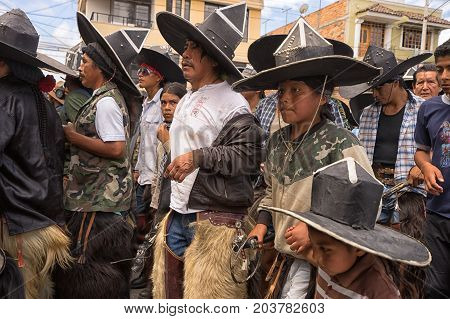 June 25 2017 Cotacachi Ecuador: kechwa indigenous men participating at the Inti Raymi parade by stomping in a tight formation