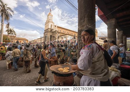 June 25 2017 Cotacachi Ecuador: vendors on the side of the main plaza offering traditional food for the parade participants at Inti Raymi