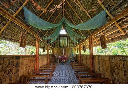 June 6 2017 Misahualli Ecuador: interior of a small church built of bamboo in the Amazon area