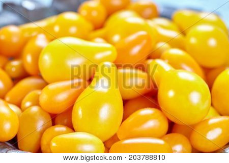 Varieties of yellow Heirloom cherry tomatoes called yellow pear and yellow datterino (or plum) cherry tomatoes.