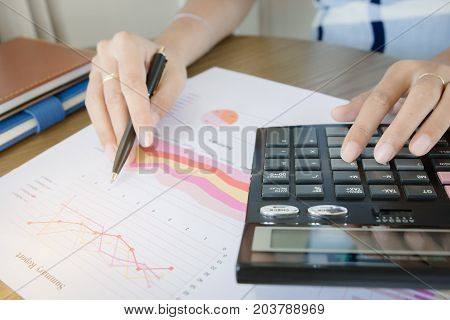 Businesswoman calculate about cost and doing finance at home office Finance managers task Concept business and finance investment