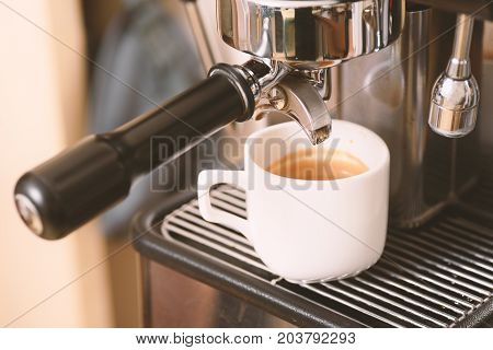 Hot coffee in a cup made from espresso machine