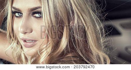 Sensual Blonde Girl In Glamour Makeup.