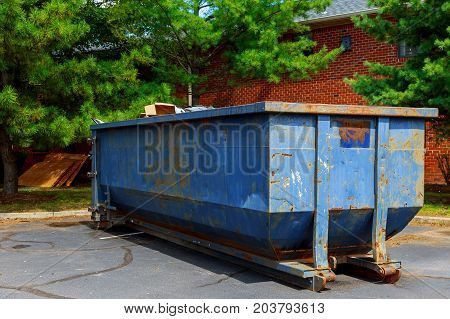 Dumpsters Being Full With Garbage In A City.