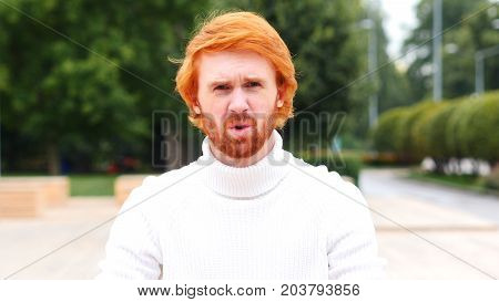 Beard Man Expressing Disappointment And Failure, Red Hairs