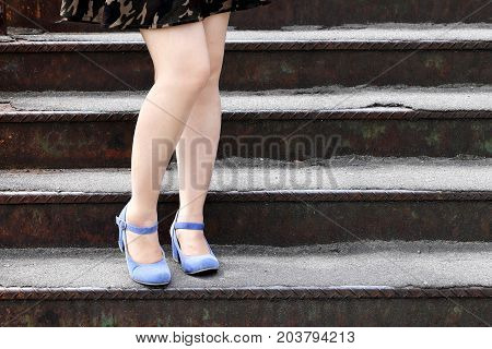 beautiful female feet in heel shoes on the stairs