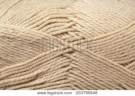 A super close up image of khaki yarn