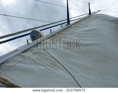 Detail of a white sail on a touristic sailboat against a cloudy sky. The picture was taken in the Beagle Channel Argentina