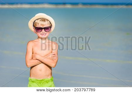 Portrait Of A Handsome Seven Years Old Boy On The Desert Sunny Beach