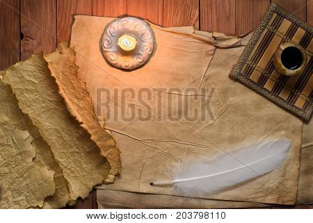 Vintage Still Life With Feather, Old Paper And Burning Candle On Canvas Background