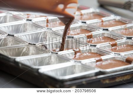 Thai bakery method baking chocolate brownie cake in pan