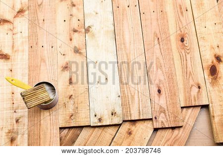 Coat the wood pallet by brush with lacquer.