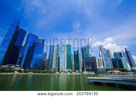 Central Business District Building Of Singapore City With Blue Sky