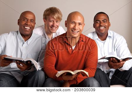 Diverse group of men studying together. Small group.