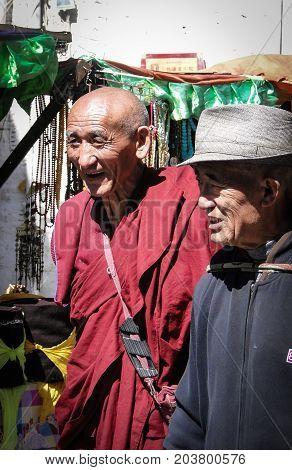 People Walk Around Jokhang Temple In Tibet