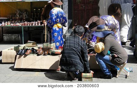 People Walk Around Jokhang Temple In Tibet