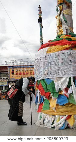 Pilgrims And Locals Praying At Jokhang Temple