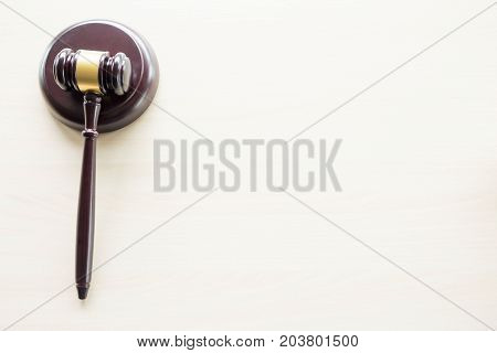 a gavel on a wooden brown desktop Law lawyer and justice concept.