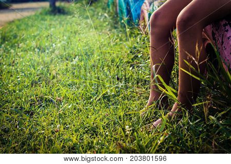 Children sitting in the playground. Swings in the playground outdoors close up.