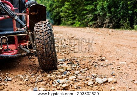 Close up Off road wheel on dirt road