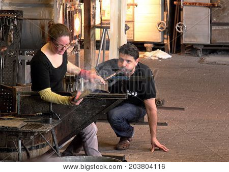 Leusden, Netherlands - April 9 2016: Glass blowers demonstrate their craft in a popular tourist attraction in Leusden, Netherlands