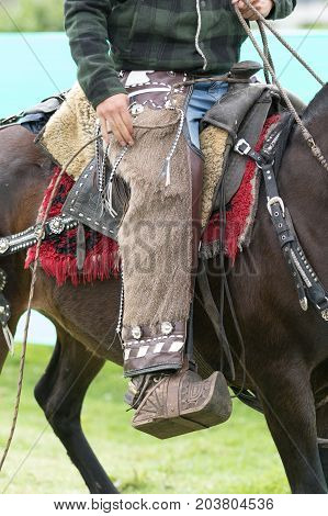 June 3 2017 Machachi Ecuador: traditional chaps detail worn by a cowboy on horseback