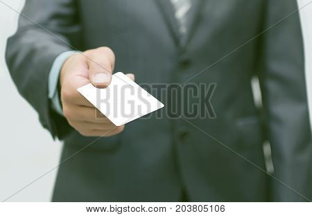 Business man is giving business card to business partner. Visit card.