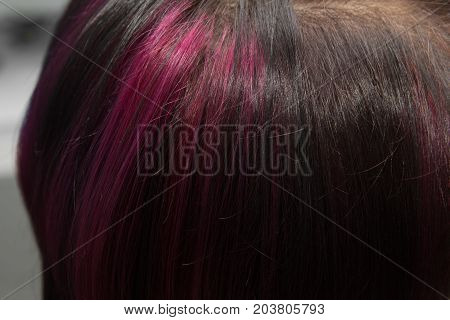 background of the hair with a pink streak