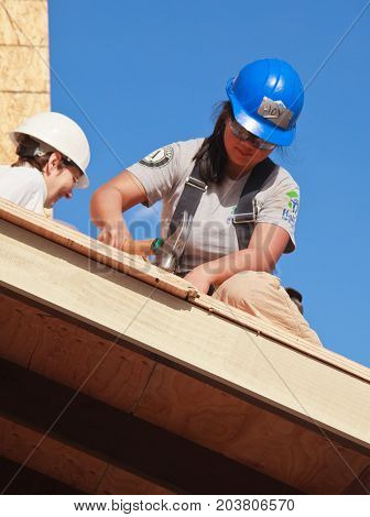 Women Build Roof For Home For Habitat For Humanity