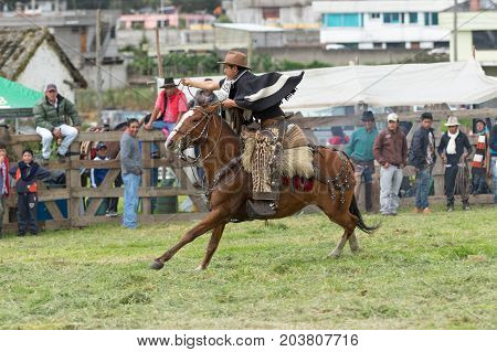 June 3 2017 Machachi Ecuador: cowboy wearing rare ocelot chaps in motion on horseback