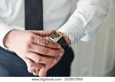 businessman clock clothes, businessman checking time on his wristwatch. men's hand with a watch, watch on a man's hand, the fees of the groom, preparation for work, man's style