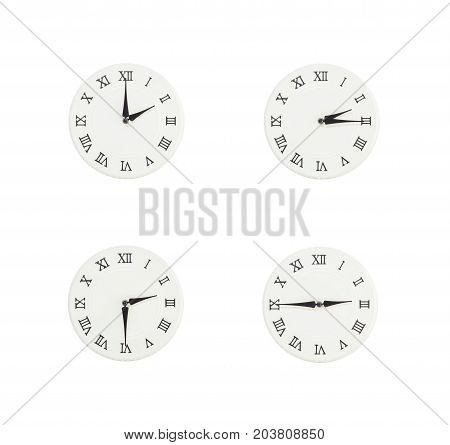 Closeup group of white clock with shadow for decorate show the time in 2 2:15 2:30 2:45 p.m. isolated on white background beautiful 4 wall clock picture in different time