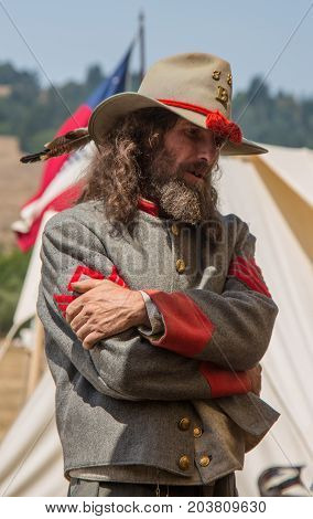 Man Stands In Confederate Uniform