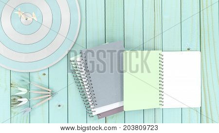 notebooks with four darts with dartboard on wooden table 3d render