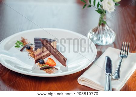 Caramel Cake, Mousse Dessert On A Plate. Grey Stone Background.