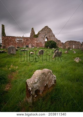 A cloudy sky over Bonamargy Friary in Antrim, Northern Ireland