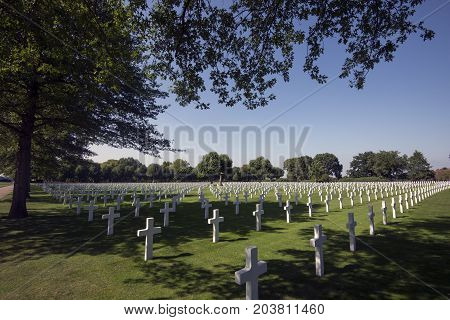 Margraten Netherlands - August 29 2017: Crosses on military graves of fallen U.S. soldiers at the Netherlands American Cemetery and Memorial.
