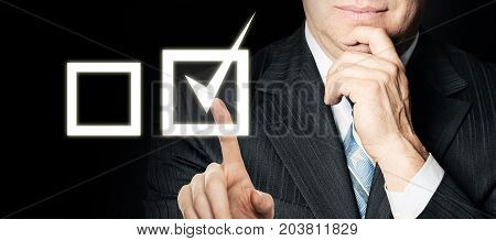 Businessman Touching Pressing Button with Ticking Check Box