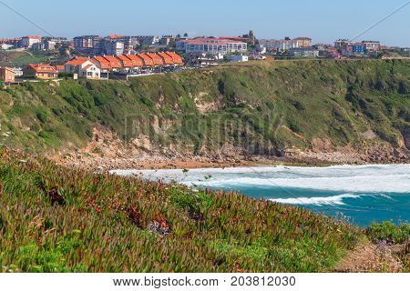 View of the town on the high coast. Spain suburb of Suances summer day in the Province of Cantabria it is photographed from Playa de Los Locos.