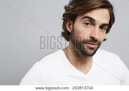 Handsome dude in white looking at camera