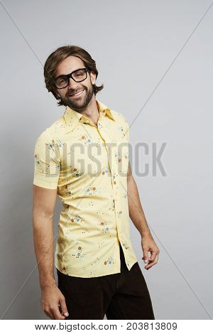 Smiling dude in yellow shirt with glasses portrait
