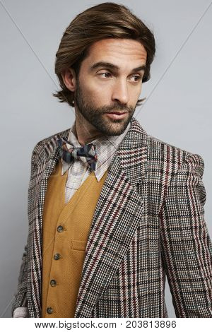 Smart geek chic guy in bow tie and jacket