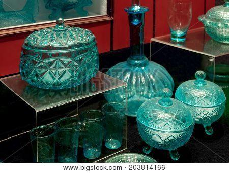 Blue vintage glassware on display. Antiques glassware.