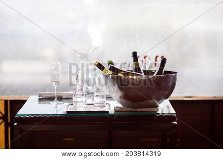 A concept of luxury life with wine bottle in ice silver bucket